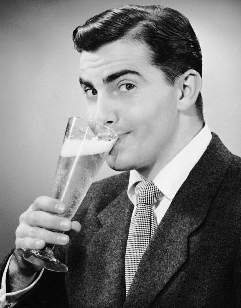 1950's beer ad shows this actor smiling into this beer which is wrong. You can get a bad case of hiccup's doing this.