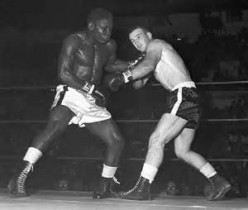 Don Fullmer, right, fought Dick Tiger three times, earning a draw and losing twice.