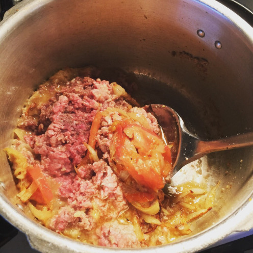 Add ground beef and stir fry until it changes color.