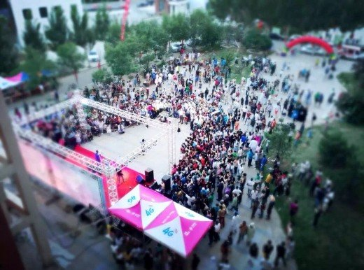 In the evening, spectators enjoying the on stage performances by students.