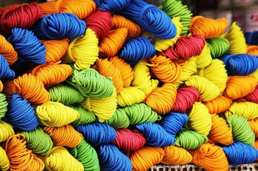 Colorful bits of yarn makes beautiful yarn art.