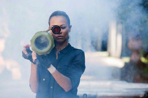 Saldana handles plenty of hardware for this explosive action movie