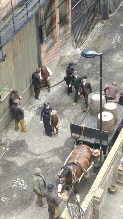 Film extras on location 'Houdini & Doyle', Manchester, England