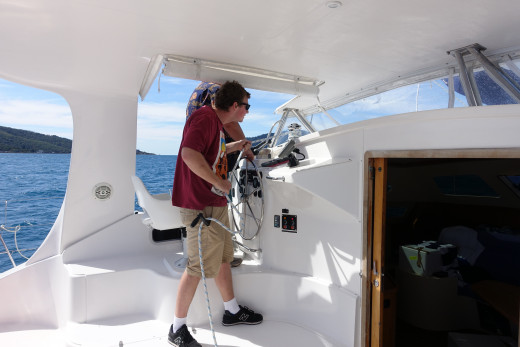 Trimming the headsail while steering