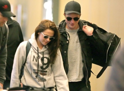 Kristen Stewart and Robert Pattinson both dress like slobs and try not to smile so that paparazzi photos make the least amount of money as possible. Tabloids don't appreciate celebs who intentionally steal from their 'livelihoods' - so harass them.