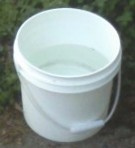 Someone suggested using the laundry plunger with a round pail like this icing bucket to do the washing, as the plunger works better. It's true! Less Irish Washerwoman style pushing up and down. I still do the rinsing in the rectangular storage tub.