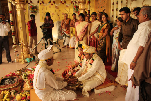 A Hindu marriage ceremony contains many religious rituals. At the end of the ceremony, the couple take seven steps, making a vow at each one. The steps represent food, strength, prosperity, well-being, children, happiness and harmony.