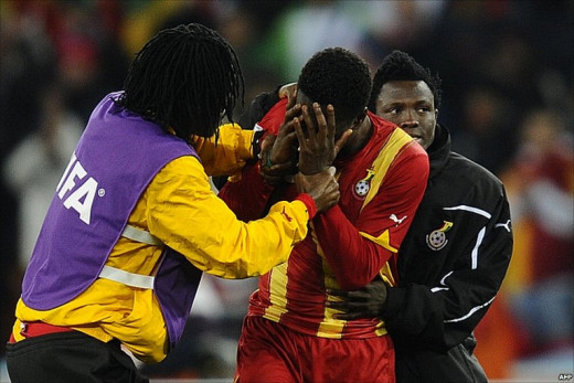 Asamoah Gyan breaks down in tears after missing his country's most important penalty ever