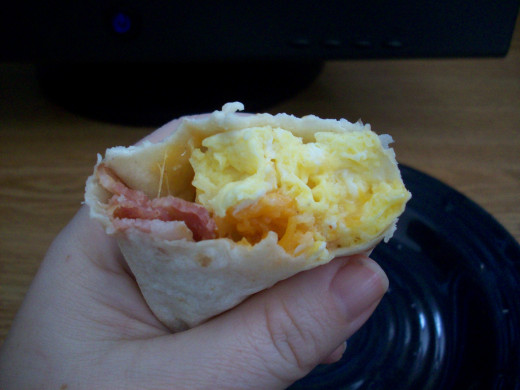 A yummy breakfast burrito full of homegrown eggs.