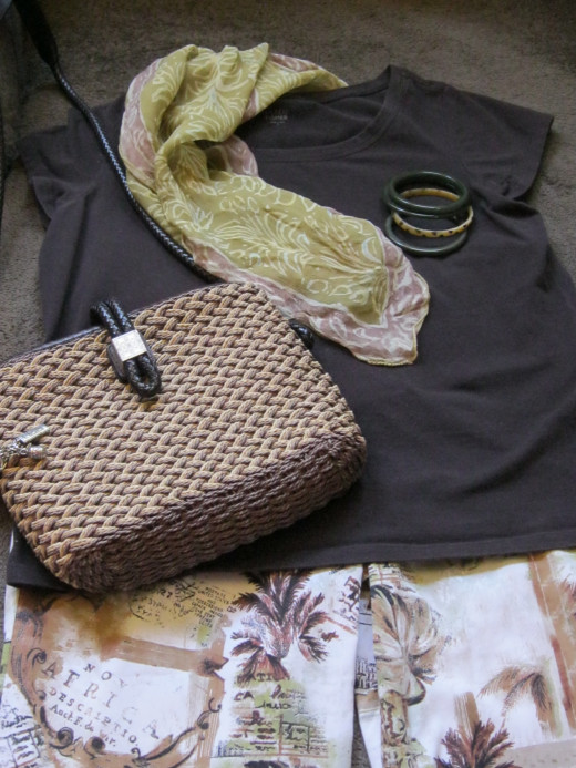 Eileen Fisher brown t-shirt $7, Green and brown print scarf $2, Bangles (4) $1 each, Brighton summer woven purse $12, Chicos Palm Tree Cotton cropped pants $12.