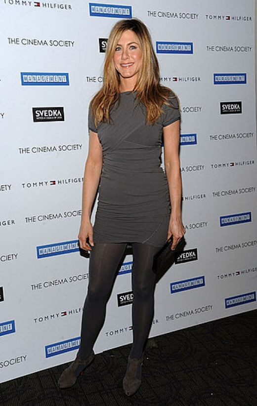 Jennifer Aniston promoting a movie in stockings and high heels