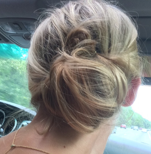 Second view of up-do done in the car on the way to the track.