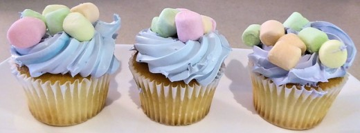 The good thing about white frosting is that you can make it any color and decorate it any way you want.