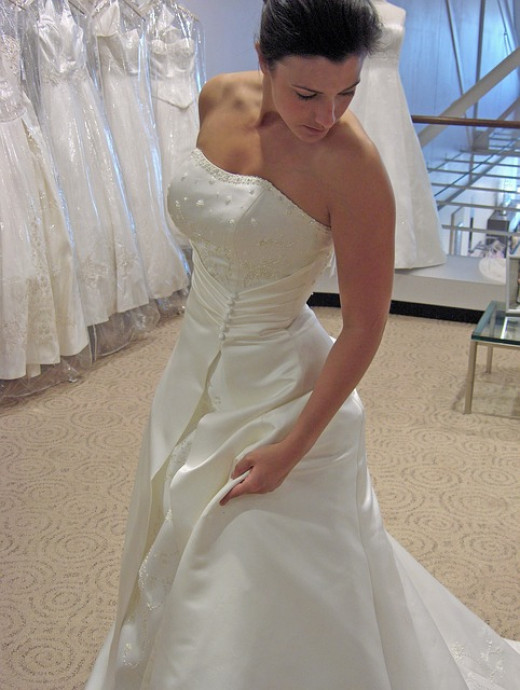 Beautiful wedding gown equally suited for an informal wedding or formal wedding.