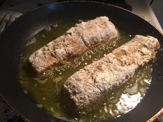 Pan frying the salmon fillets