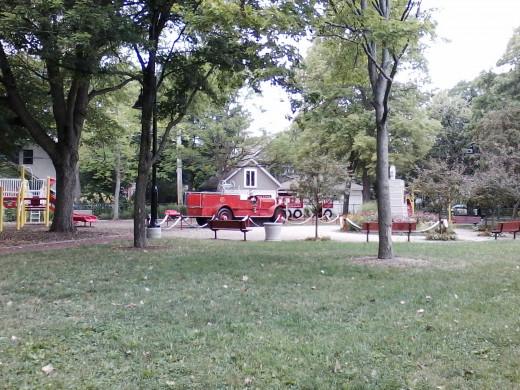 A neighborhood park with a fire engine.