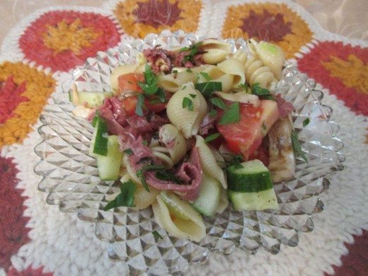 Dish of Pasta Salad w/Pastrami, Mushrooms and cucumbers