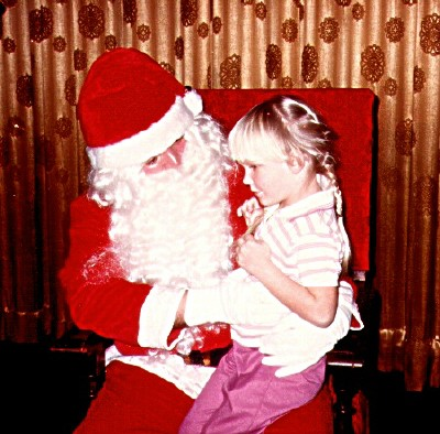 My niece seems a little unsure about Santa in this photo.