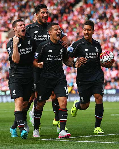 Coutinho celebrates his match-winning goal with Milner, Can and Firmino