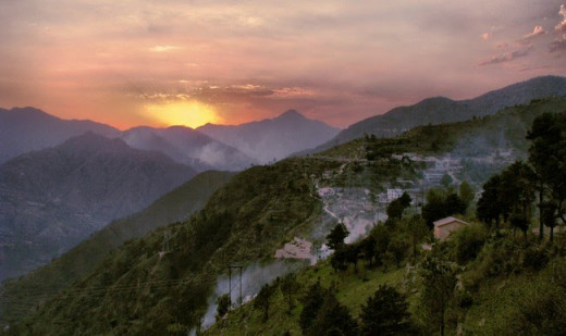 Crimson colored sun rays bidding farewell to the hills of Chamba