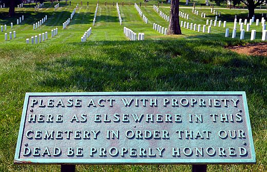 Signs encourage the quiet atmosphere of the cemetery despite the presence of thousands of tourists. © Scott Bateman