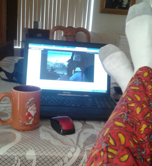 A rare glimpse into the inside of my writer's studio, with me patiently awaiting the arrival of my muse.  Superman pajama bottoms give me the psychological boost I need.  Coffee in the Grumpy cup is not optional.