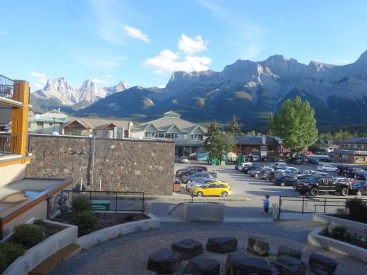 A sunny day in Canmore. View from our balcony. with the Three Sisters Peaks in the distance.