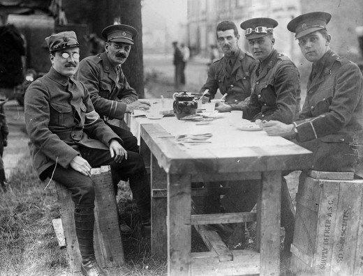 French and English officers share a break. In America photos such as this confirm Americas growing sympathy with the Allies.