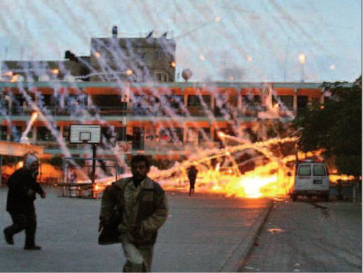 An Israeli white phosphorus round explodes over a Gaza residential area.