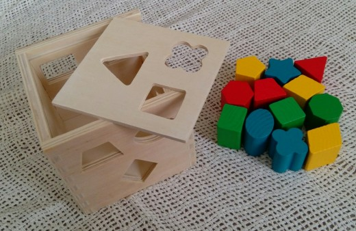 Melissa and Doug Shape Sorting Cube, educational toy. (author's own photo)