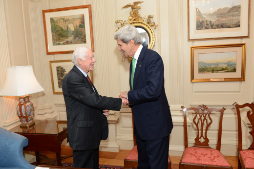 President Jimmy Carter shakes hands with Secretary John Kerry.