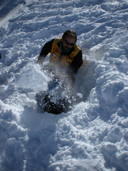 This man is desperately trying to outrun an avalanche.