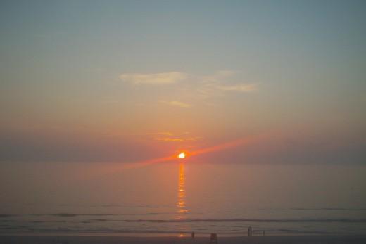 Sunrise over Calm Ocean