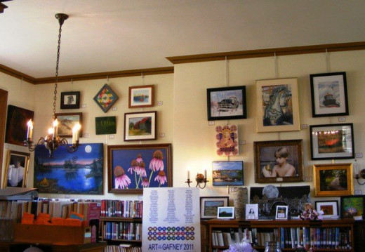 The library holds this annual art in the library raffle. People buy tickets to win the art that is donated by local artists.