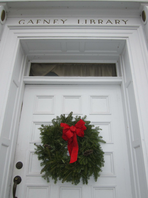 Being in New Hampshire, this library makes use of a local resource to make wreaths to sell.