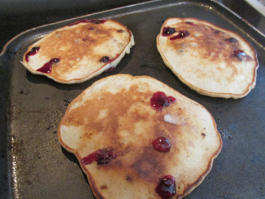 ... Banana and Blueberry Pancakes Topped with Vanilla, Cinnamon Butter