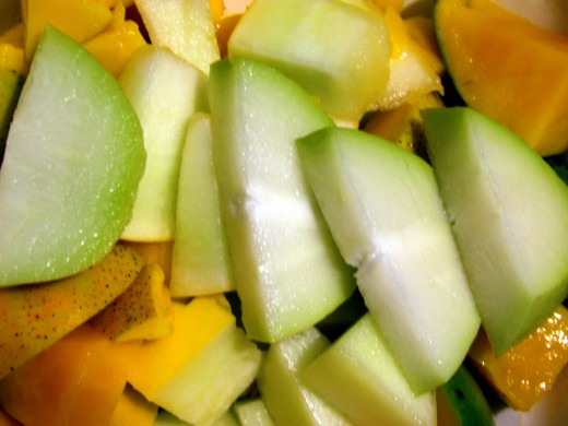 Sliced chayote, one mango, two cups golden honeydew. Naturally raw, naturally vegan.