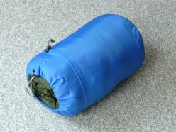 A stuff-sack is the best way to transport sleeping bags these days, as it keeps them from unrolling all over the place