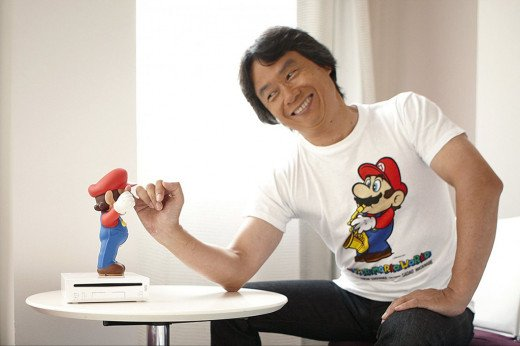 Shigeru Miyamoto shakes hands with arguebly his greatest contribution to gaming: Mario.
