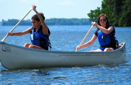 Two people sharing a canoe