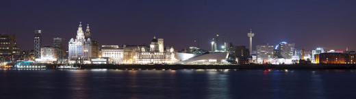 The Three Graces, museums, Pierhead and St.John's Tower seen from the river Mersey at night.