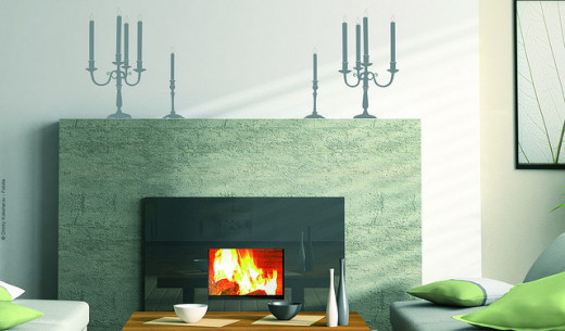 Here wallstickers in the shape of candlesticks add interest to a plain white wall.
