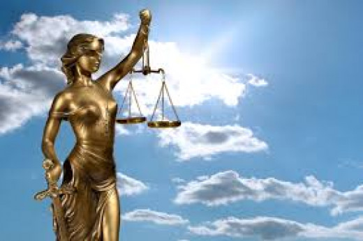 At some point, and with much thought, an artist depicted JUSTICE as a force equipped to mete out punishment, blinded to all favoritism, and balanced for punishment to fit the crime with fairness to all.