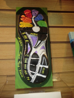 Fleet Feet hosts Art and Sole Charity event: turns old running soles into art work to benefit the Rape Crisis Center