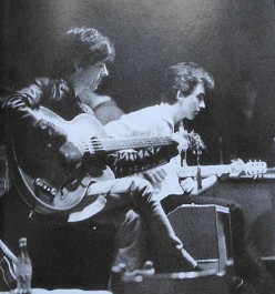 Sutcliffe (left) with George Harrison