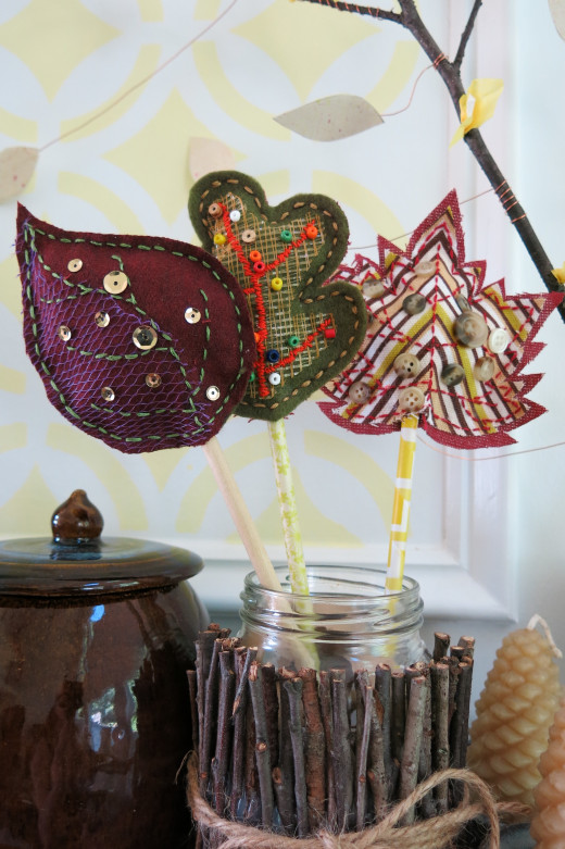 There are many ways to display these scrap fabric fall leaves to create a cheerful autumn decoration.
