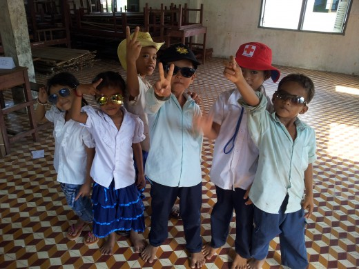 Children from Khalid Walid centre based in Kampung Chnang, Cambodia dressing up as celebrities, policeman and fireman as part of an English lesson on common jobs and their respective outfits.