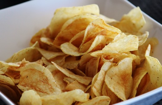 Snacking on potato chips