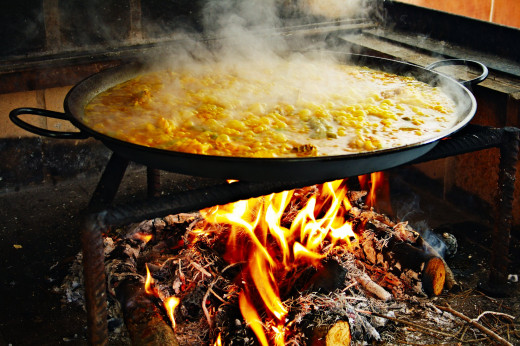 Paella is traditionally cooked over an open fire. Inside you can use a wok burner or your stove, two burners or a single one. Ensure the pan is rotated to ensure even cooking.