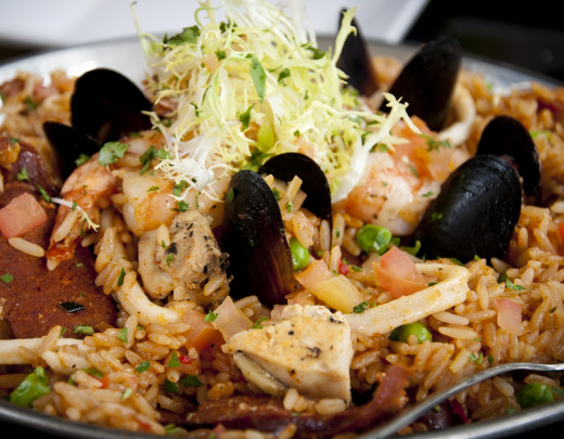 You can add chicken to a traditional seafood paella to add variety to the taste